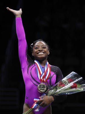 Simone Biles reacts after being named the overall all-around champion at the 2014 P&G Championships at the CONSOL Energy Center on Aug. 23, 2014.