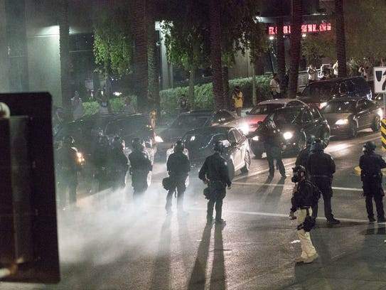 Protesters are hit by gas from Phoenix police outside