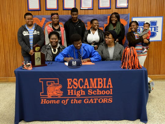 Escambia High School's Gerold Bright signs a letter