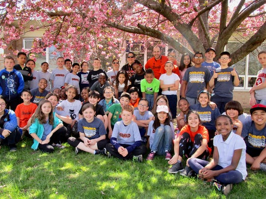 The School 9 fourth-grade classes of Theresa Rogakos, Danielle Lorenzetti and Mitch Gorbunoff gathered together after cleaning up the front of the school and neatening up the landscaping.