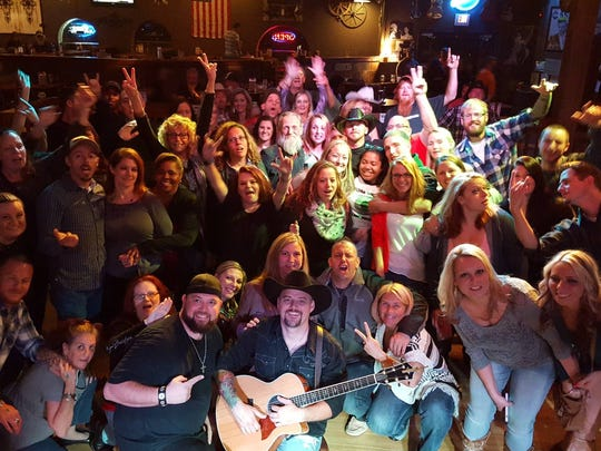 Smyrna-based Country By Night with fans at Dover's Cowboy Up club.
