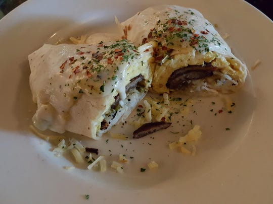 The Breakfast Burrito ($8), packed with eggs, hash browns, Hatch green chile and a choice of jalapeno bacon or sausage, served at St. Clair Winery and Bistro, 1720 Avenida de Mesilla.