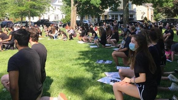 Participants took a knee in memory of George Floyd, a Black man who died in police custody -- at a vigil held June 2 on Westford Common. Floyd's death was ruled a homicide following an autopsy, and sparked worldwide outrage. The Select Board and School Committee have  formed a panel to study issues of race, diversity, and inclusion.