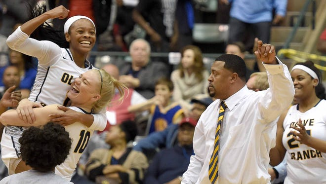 Myah Taylor celebrates her first state championship with teammates, beating Starkville 57-54.