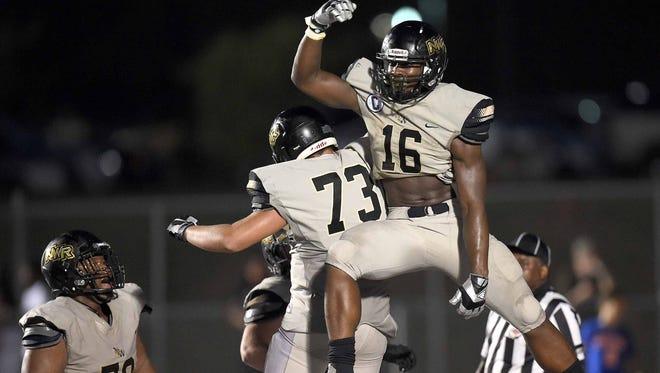 Northwest Rankin's Cameron Carroll (16) celebrates his touchdown against Ridgeland Titan with lineman Ayden McCollough (73) on Friday at Ridgeland.