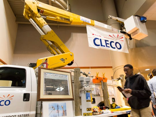 Students gather near a CLECO repair truck at the 17th annual Career Connections Expo  at the Cajundome Convention Center in Lafayette. About 4,000 high school students from Lafayette, Iberia, St. Martin and Vermilion parishes discussed career opportunities with business representatives from various fields.