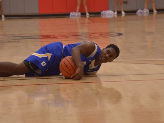 Ontario guard Tavion Harris dives on the floor for