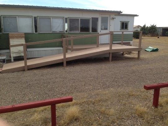 Deming Elks Mike Leyba of Chaparral Construction and his crew built a handicapped accessible ramp through grant money provided by the state Elks Cerebral Palsy Fund.