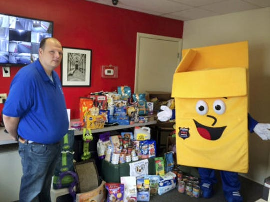 U-Stor-It's mascot Phillup the Box and Jamie of the