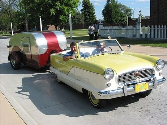 Rhonda Gelstein pulls one of her trailers from behind the wheel of her 1958 Nash.