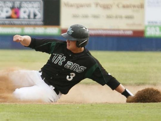 West Salem's Brody Wittman slides into second in an OSAA quarterfinal game on Friday, May 27, 2016.