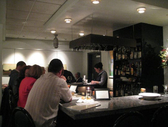 The gray granite bar at the Freelance Cafe