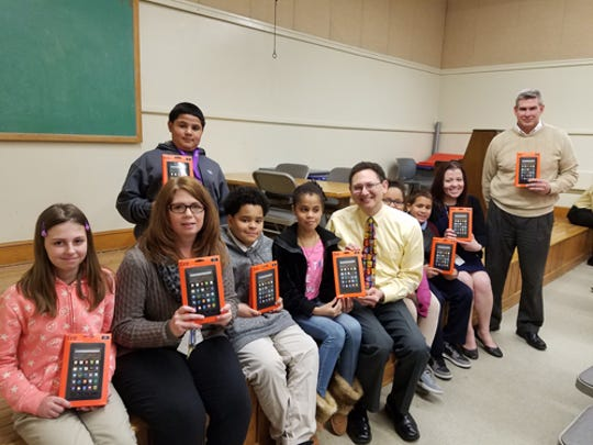 Sixty new Kindles with jackets were presented to the