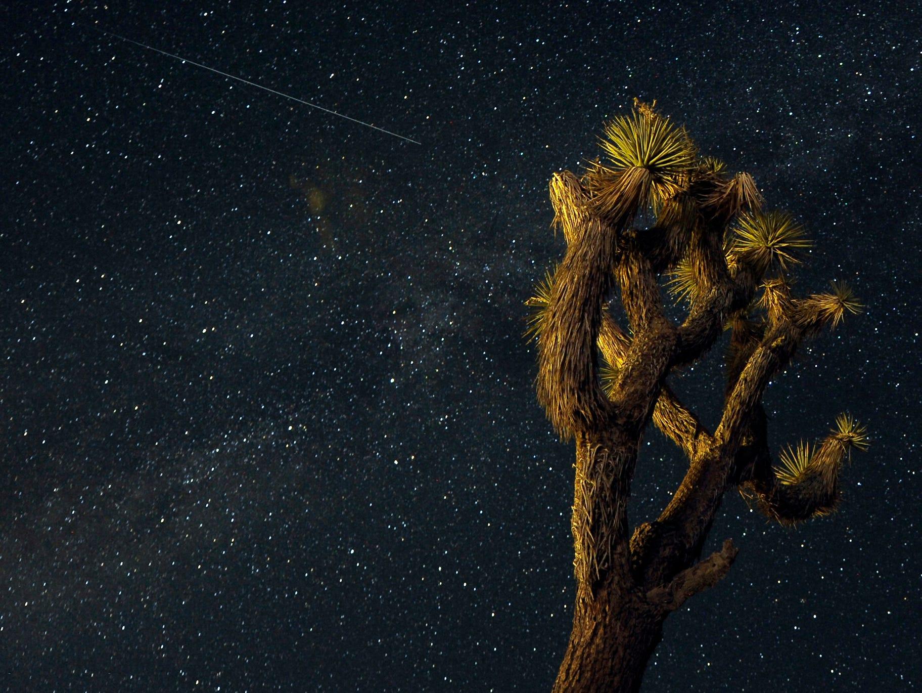 A meteor passes over the Mojave Desert in Landers, Calif.