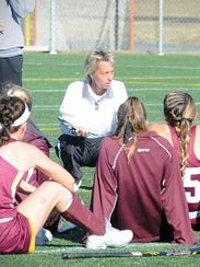 Salisbury head coach Dawn Chamberlin talks to her team