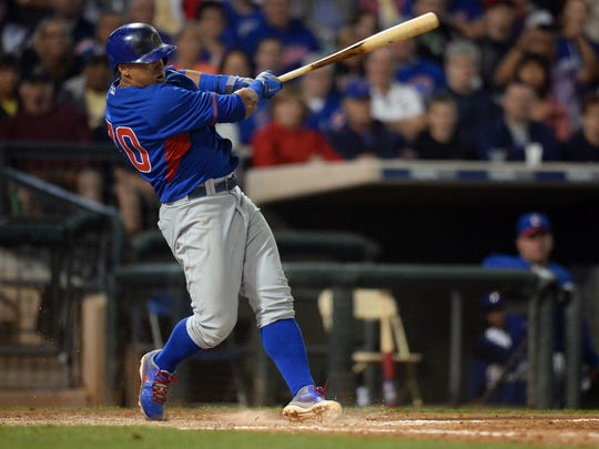 Chicago Cubs shortstop Javier Baez (70) follows through on a swing against the Texas Rangers at Surprise Stadium.