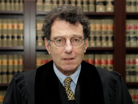 "U.S. District Judge Dan Polster has called the opioid addiction epidemic ""100 percent man-made"" and asserted that other branches of government have ""punted"" on solving it."