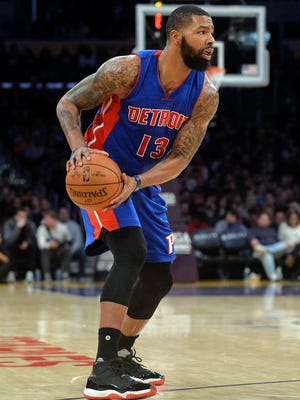 Pistons forward Marcus Morris (13) controls the ball against the Lakers during the first half of the Pistons' 102-97 win Sunday in Los Angeles.