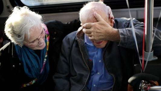 Anne Fracassa, 76 hugs her husband Angelo Fracassa, 86 as he gets overcome with emotion.