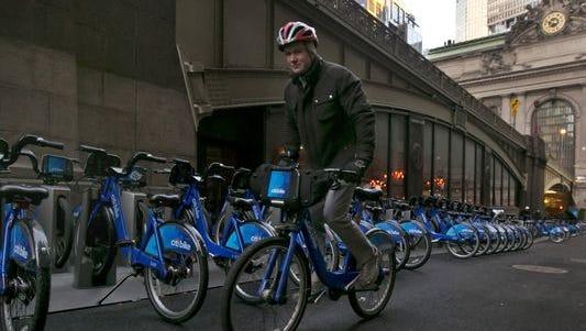A Citi Bike cyclist picks up his ride near Grand Central in New York.