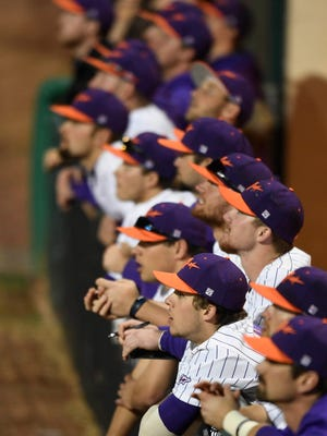 The Aces dugout watches action on the field as University of Evansville plays SIUE at Braun Stadium Wednesday, March 29, 2017.