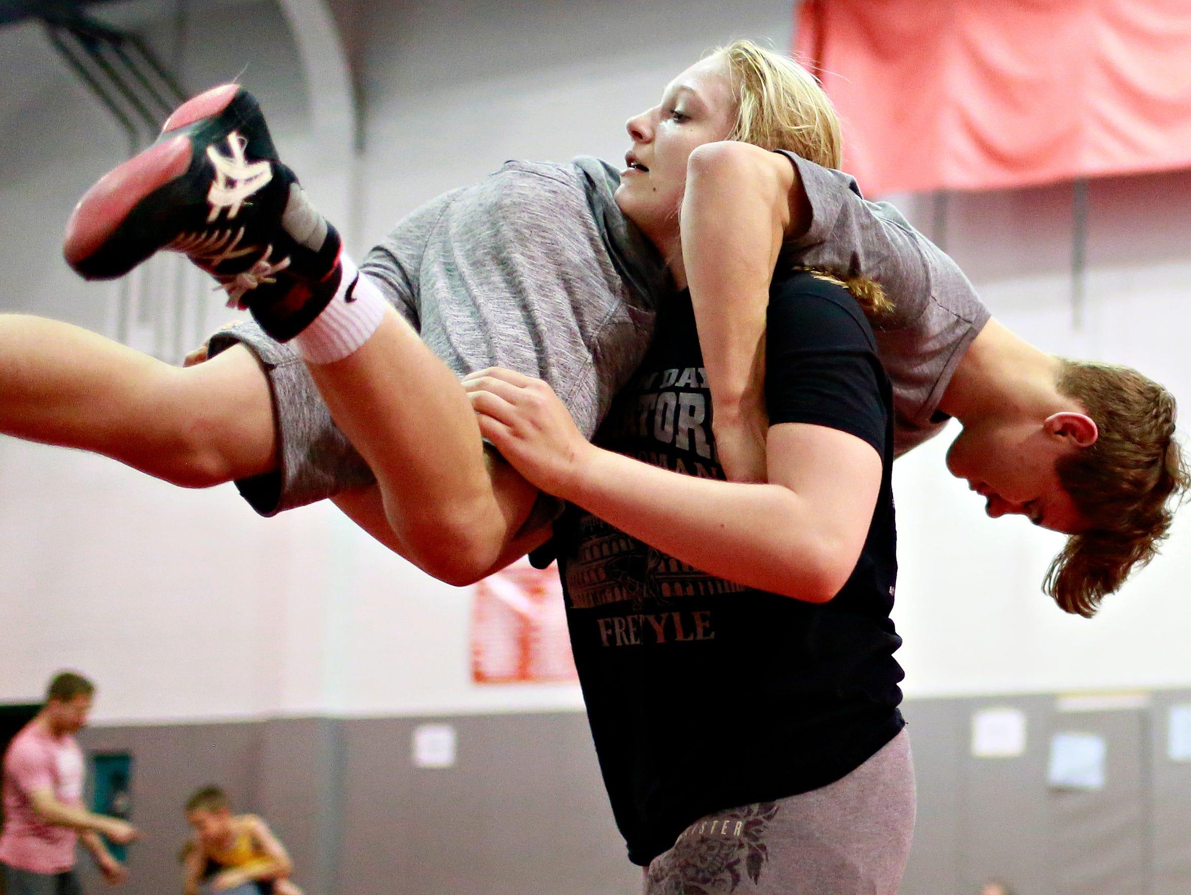 Tiffani McNelis, 14, of Stewartstown, lifts Mason Lewis,