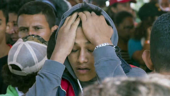 Central American migrants gathered April 7, 2018, outside a church in Puebla, Mexico, for a caravan that has been traveling toward the U.S.-Mexico border to draw attention to gang violence in Honduras and neighboring countries.