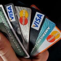 FILE - In this March 5, 2012, file photo, consumer credit cards are posed in North Andover, Mass.