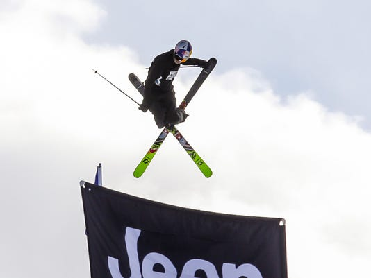 Nick Goepper helicopters on the last jump during qualifying for the men's slopestyle during the Winter X Games on Friday, Jan. 26, 2018, in Aspen, Colo. Goepper placed third. (Chris Dillmann/Vail Daily via AP)