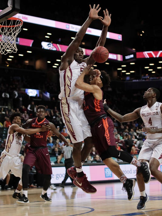 Virginia Tech guard Seth Allen (4) attempts to drive to the basket against Florida State center Michael Ojo (50) in the first half of an NCAA college basketball game during the quarterfinals of the Atlantic Coast Conference tournament, Thursday, March 9, 2017, in New York. (AP Photo/Julie Jacobson)