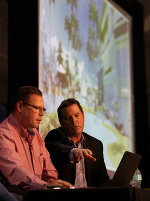 John Hafner and Tom Torgerson talk about concept drawings at the Grand Resorts - Fort Myers Beach public meeting Thursday at the Bay Oaks recreation center on Fort Myers Beach.