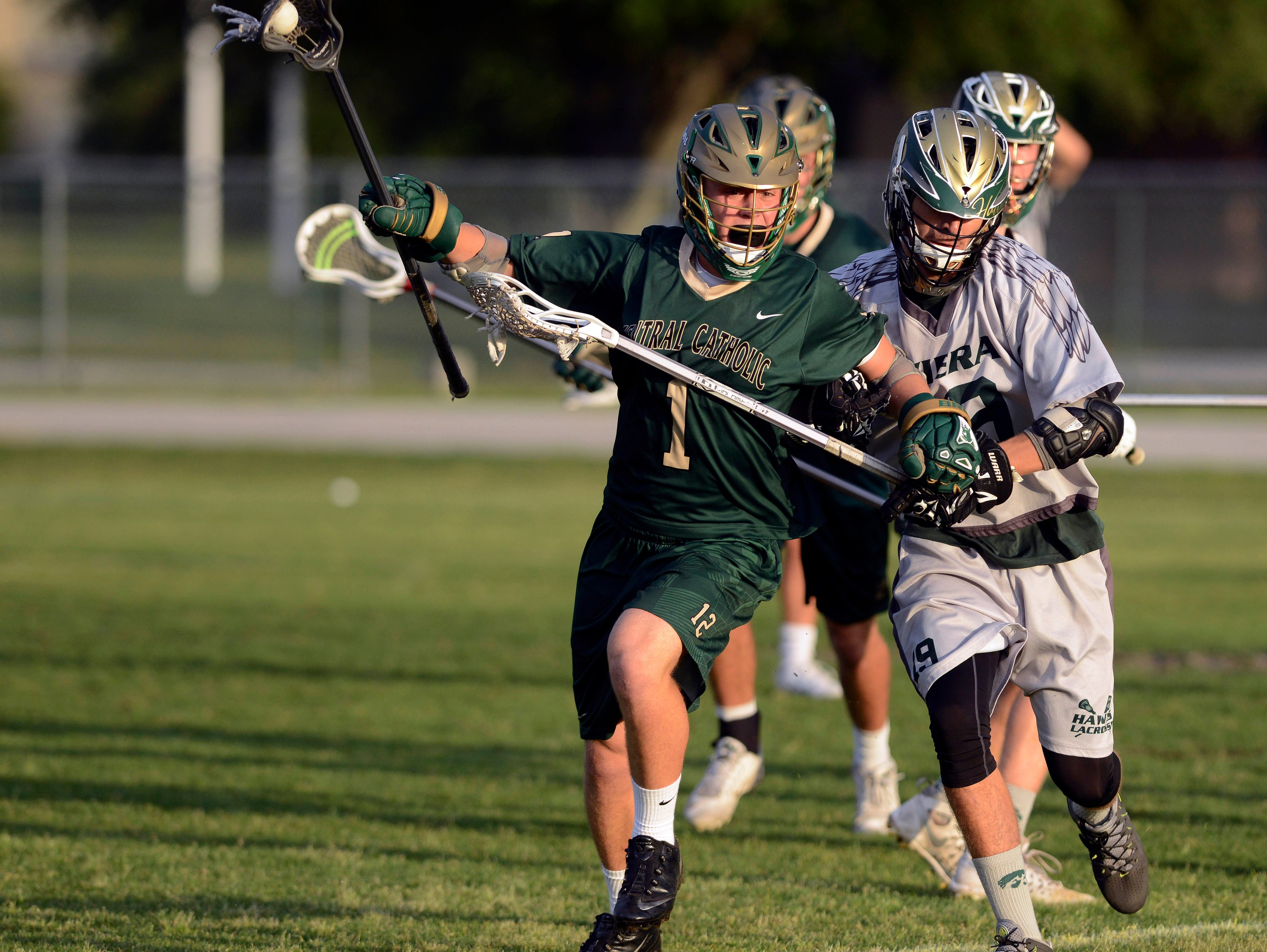 Viera's Griffni Syverson (19) tries to dislodge the ball from Bryce Fielding of MCC during Friday's playoff game in Viera.