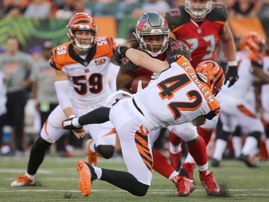 Cincinnati Bengals safety Clayton Fejedelem (42) tackled