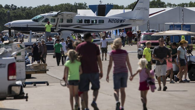 A Wipline 8750 Grand Amphibian is towed into place as vendors set-up on Sunday for AirVenture's 2015 opening day.