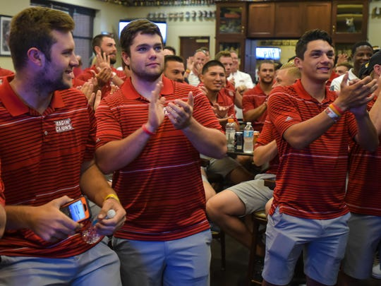 Members of the UL Ragin' Cajuns baseball team clap when seeing the details of the Lafayette Regional during ESPN's broadcast of the baseball pairings Monday.