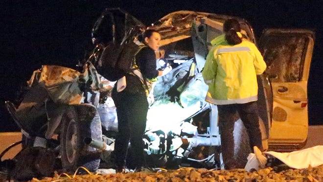 Investigators shine a light on a mangled vehicle following a fatal traffic accident along I-10 East between Redd and Thorn Thursday night.