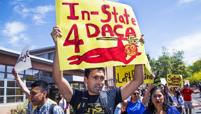 """Arizona State University students walk on the Tempe campus in 2015 in support of in-state tuition for so-called """"dreamers."""""""