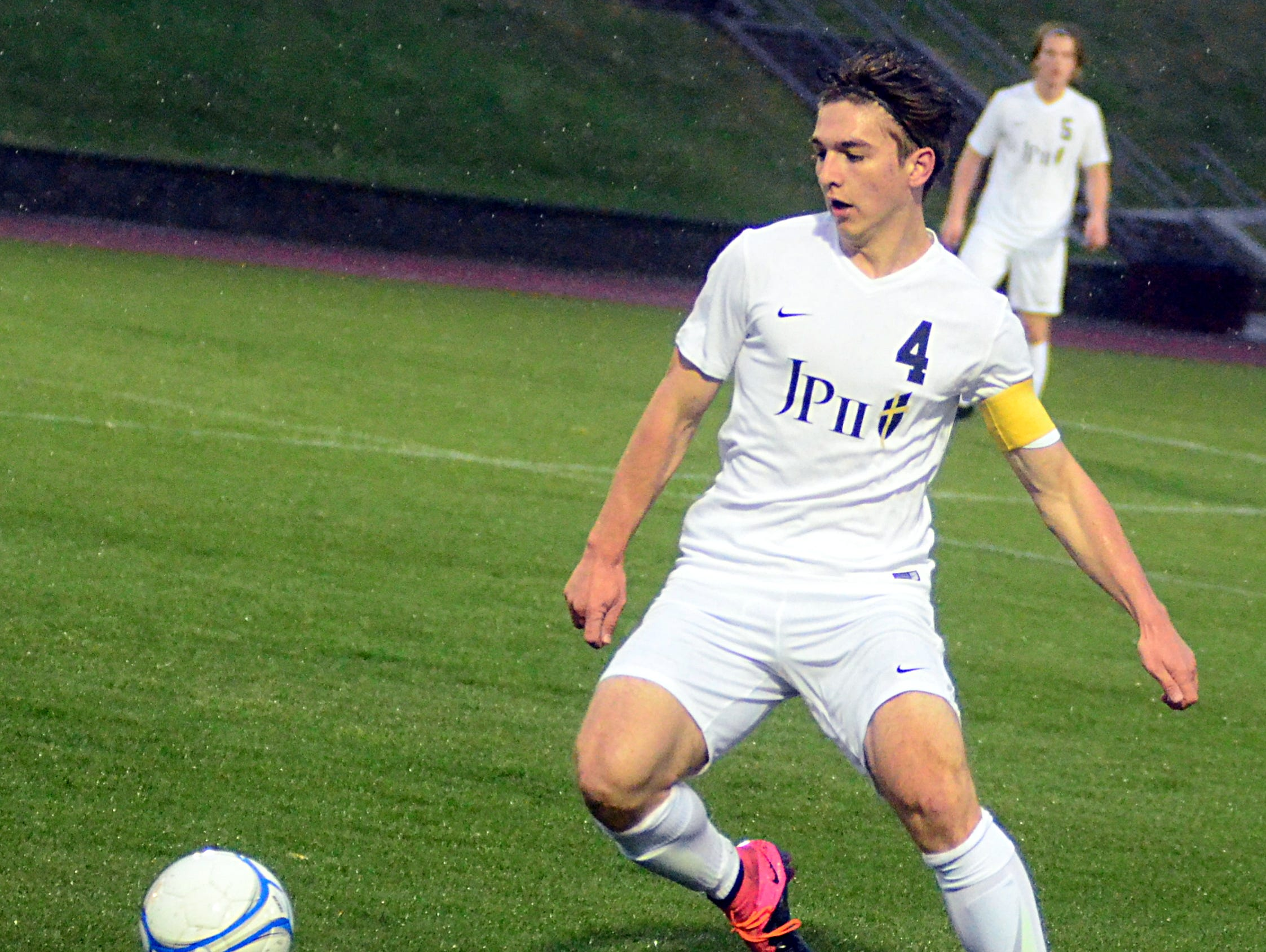Pope John Paul II High senior Tristen McTasney gains possession during first-half action.