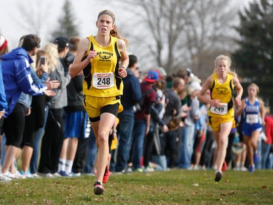 Mid-Prairie Wellman runner Anna Hostetler (left) leads