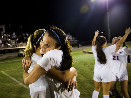 The Estero High School soccer team celebrates after winning the class 4A state semifinal against Archbishop McCarthy High School on Friday, February 16, 2018 at Estero High School.