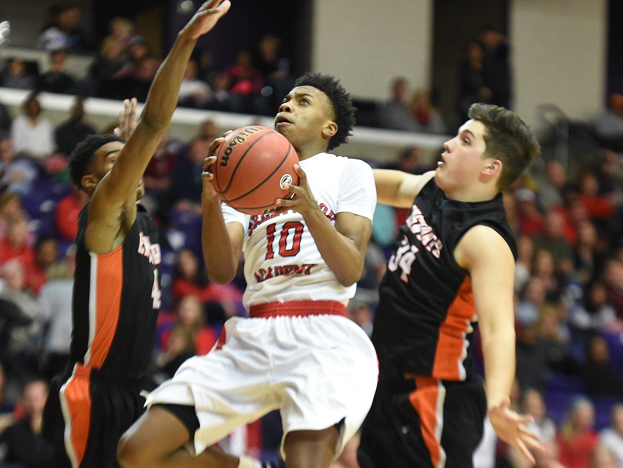 Brentwood Academy's Darius Garland (10) shoots betweeen Enworth's Caleb Upkins (4) and Tanner Antonetti in action last year in Nashville.