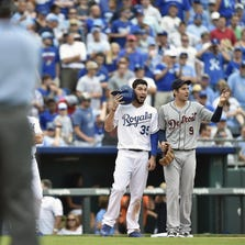 Kansas City's Eric Hosmer and Detroit's Nick Castellanos wait for umpires to decide the fate of the Tigers' appeal Saturday.