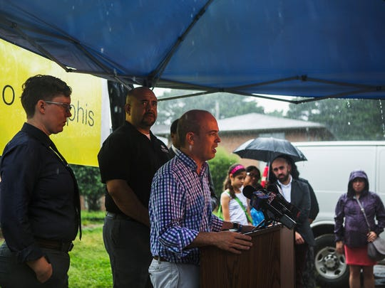 "July 28, 2017 - Casey Bryant (left), legal director for Latino Memphis, and Pastor Greg Diaz of Nueva Direccion Memphis, stand behind Mauricio Calvo, executive director of Latino Memphis, as he delivers a statement to members of the press at Prescott Place Apartments on Friday morning to denounce random arrests of Hispanics. Apparently on Sunday, agents from the U.S. Customs and Immigration Enforcement (ICE) started conducting federal immigration arrests in Memphis that have continued for several days. ""I'm here to tell you they are not criminals,"" Calvo said. ""And our city is not safer because they are taking people who are innocent."""