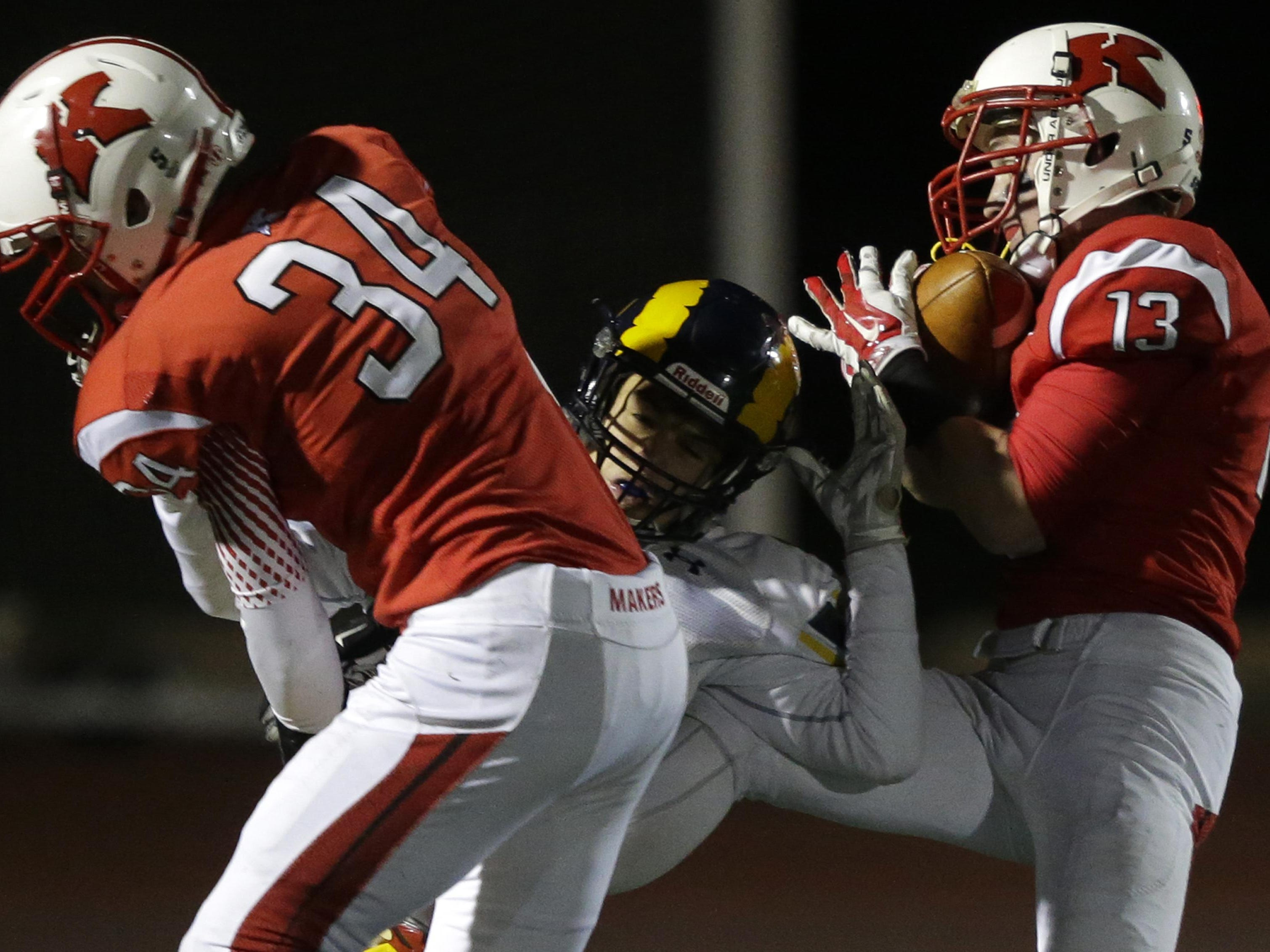Bailey Marasch (right) makes an interception during Kimberly's state semifinal win over Marquette on Nov. 13.
