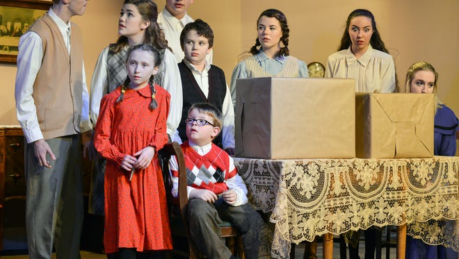 """The children gather during Wednesday's dress rehearsal for the upcoming performance of """"Cheaper By The Dozen"""" at What A Do Theater."""