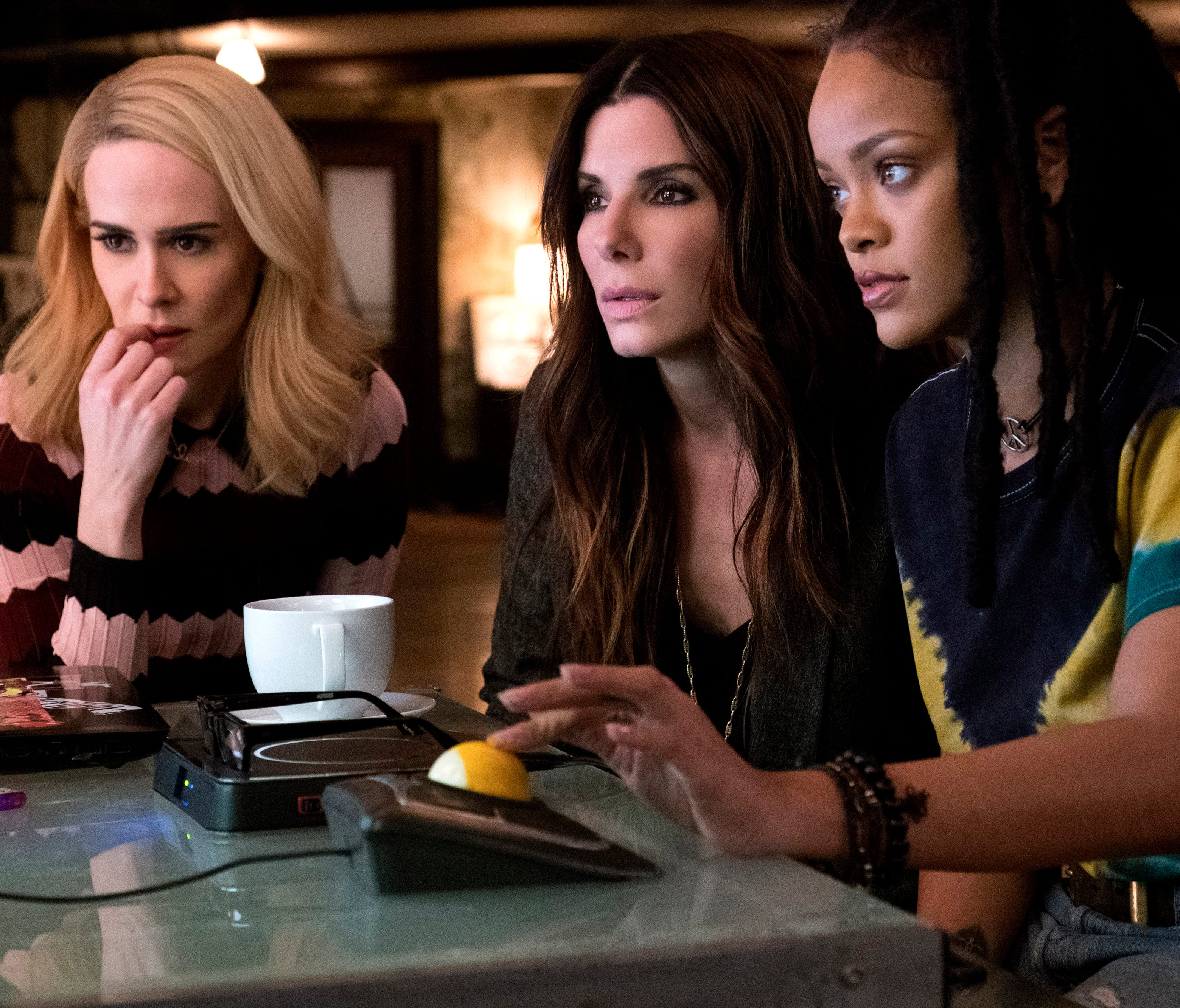 Sarah Paulson (left), Sandra Bullock and Rihanna star in the heist comedy