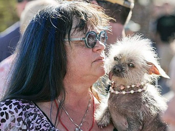 Linda Elmquist, of Tucson, holds her dog Josie during the 2013 World's Ugliest Dog Contest.