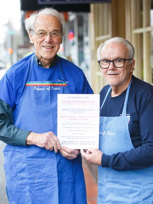 John Mortensen, left, and Carl Newswanger, right, advertise the Prince of Peace Episcopal Church's Pancake Fundraising Dinner at Holding Court on Tuesday, Feb. 21, 2017.