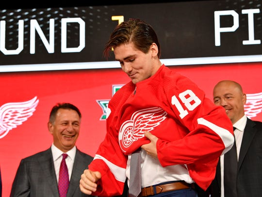 Filip Zadina puts on a Detroit Red Wings jersey after being selected as the No. 6 overall pick in the first round of the 2018 NHL draft at American Airlines Center in Dallas on June 22.
