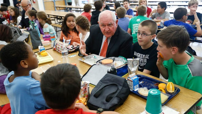 Agriculture Secretary Sonny Perdue has lunch with students in the cafeteria at Catoctin Elementary School in Leesburg, Va., on May 1, 2017.